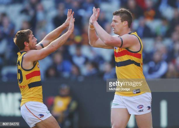 Josh Jenkins of the Crows celebrates a goal during the round 15 AFL match between the Carlton Blues and the Adelaide Crows at Melbourne Cricket...