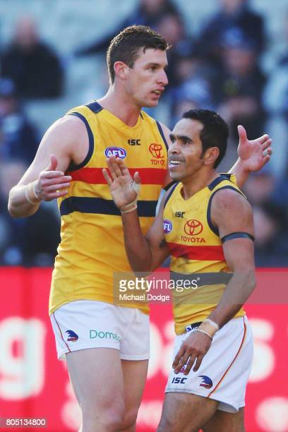 Josh Jenkins of the Crows celebrates a goal with Eddie Betts during the round 15 AFL match between the Carlton Blues and the Adelaide Crows at...