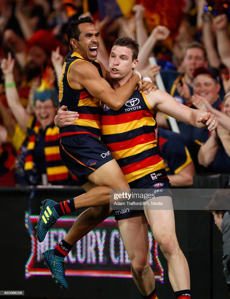 Josh Jenkins of the Crows (right) celebrates a goal with Eddie Betts of the Crows during the 2017 AFL First Preliminary Final match between the Adelaide Crows and the Geelong Cats at Adelaide Oval on September 22, 2017 in Adelaide, Australia.