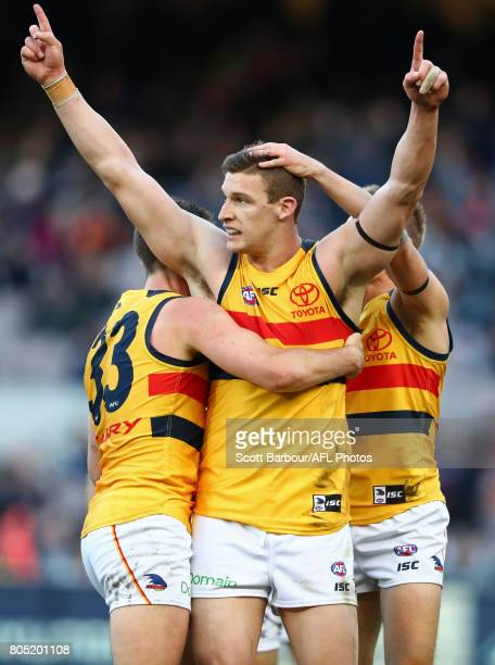 Josh Jenkins of the Crows celebrates after kicking a goal during the round 15 AFL match between the Carlton Blues and the Adelaide Crows at Melbourne...