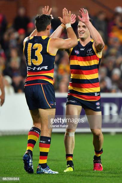 Josh Jenkins of the Crows is congratulated by Taylor Walker of the Crows after kicking a goal during the round eight AFL match between the Adelaide...