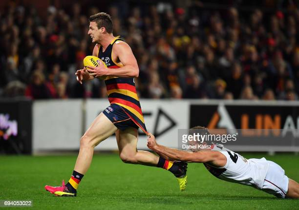Josh Jenkins of the Crows is tackled by Nathan Brown of St Kilda during the round 12 AFL match between the Adelaide Crows and the St Kilda Saints at...