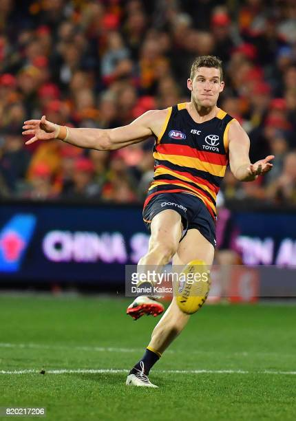 Josh Jenkins of the Crows kicks the ball during the round 18 AFL match between the Adelaide Crows and the Geelong Cats at Adelaide Oval on July 21...