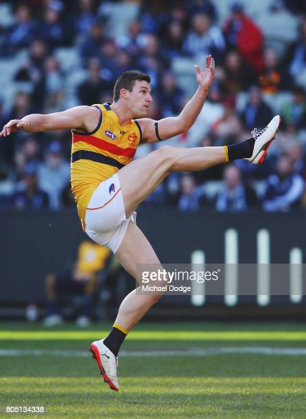 Josh Jenkins of the Crows kicks the ball for a goal during the round 15 AFL match between the Carlton Blues and the Adelaide Crows at Melbourne...