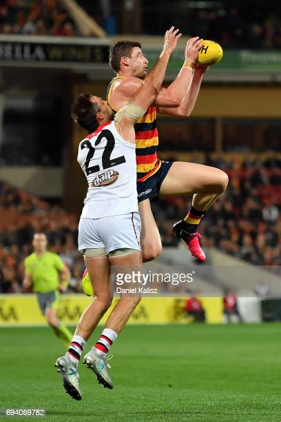 Josh Jenkins of the Crows marks the ball over Nathan Brown of the Saints during the round 12 AFL match between the Adelaide Crows and the St Kilda...