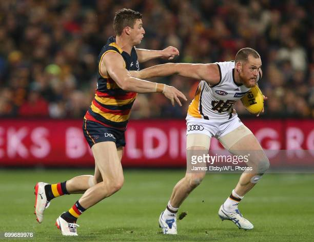 Josh Jenkins of the Crows tackles Jarryd Roughead of the Hawks during the 2017 AFL round 14 match between the Adelaide Crows and the Hawthorn Hawks...