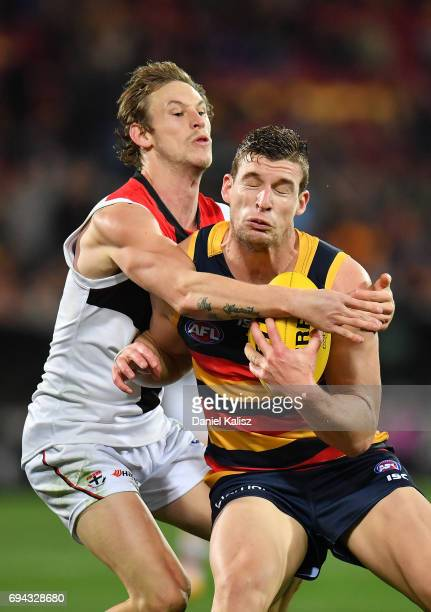 Josh Jenkins of the Crows tries to evade a tackle during the round 12 AFL match between the Adelaide Crows and the St Kilda Saints at Adelaide Oval...