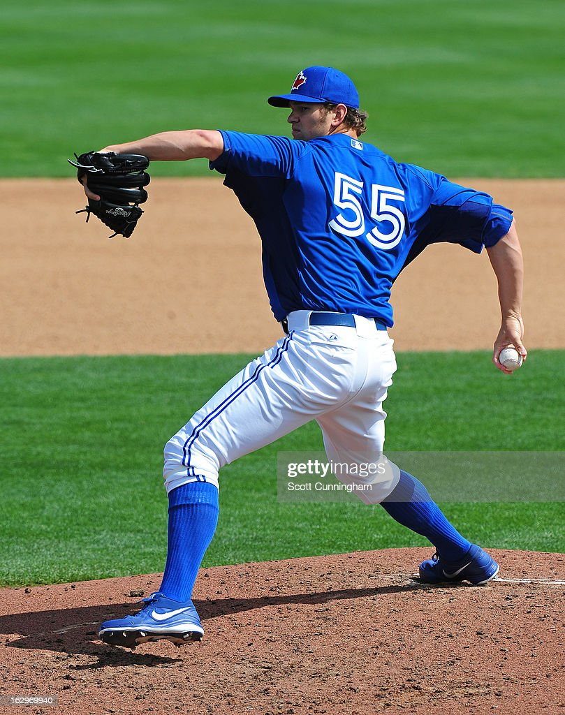 Josh Johnson #55 of the Toronto Blue Jays pitches during a spring training game against the Philadelphia Phillies at Florida Auto Exchange Stadium on March 2, 2013 in Dunedin, Florida.