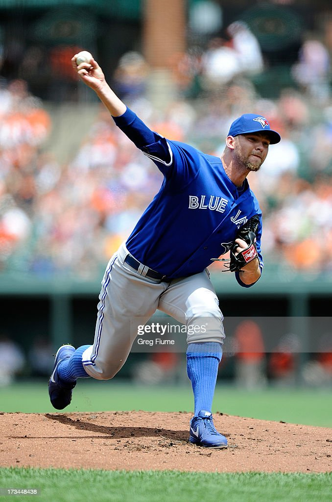 Josh Johnson #55 of the Toronto Blue Jays pitches in the first inning against the Baltimore Orioles at Oriole Park at Camden Yards on July 14, 2013 in Baltimore, Maryland.