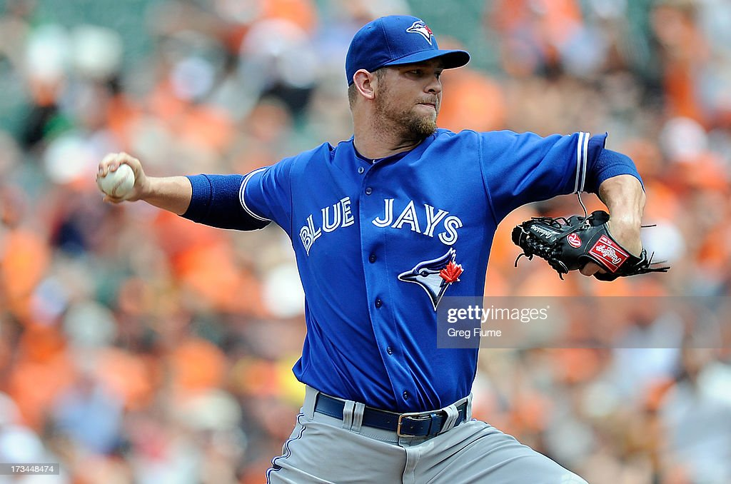 Josh Johnson #55 of the Toronto Blue Jays pitches in the second inning against the Baltimore Orioles at Oriole Park at Camden Yards on July 14, 2013 in Baltimore, Maryland.