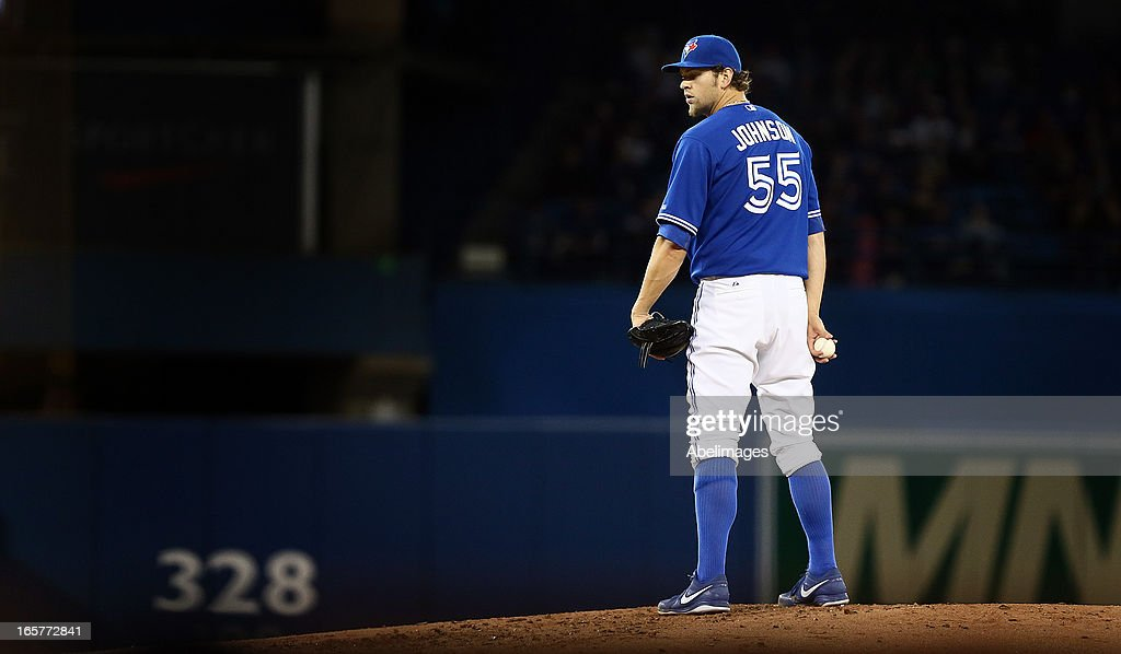 Josh Johnson #55 of the Toronto Blue Jays prepares a pitch against the Boston Red Sox during MLB action at the Rogers Centre April 5, 2013 in Toronto, Ontario, Canada.