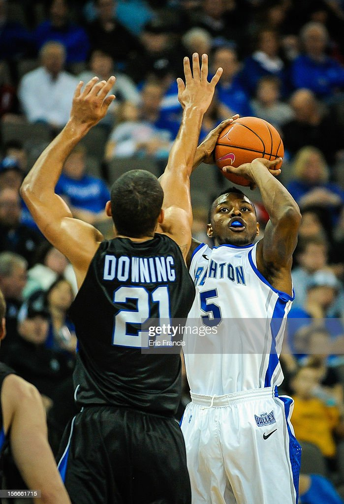 Josh Jones #5 of the Creighton Bluejays shoots over Jordan Downing #21 of the Presbyterian Blue Hose during their game at CenturyLink Center on November 18, 2012 in Omaha, Nebraska.
