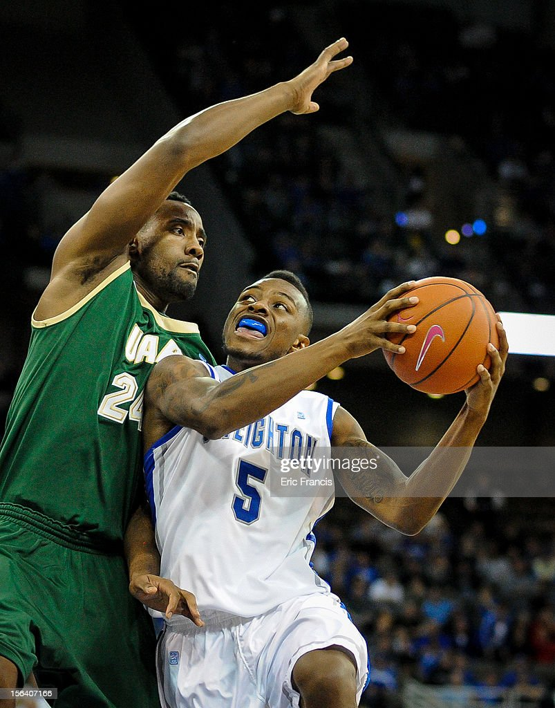 Josh Jones #5 of the Creighton Bluejays takes the ball to the hoop against Preston Purifoy #24 of the UAB Blazers during their game at CenturyLink Center on November 14, 2012 in Omaha, Nebraska.