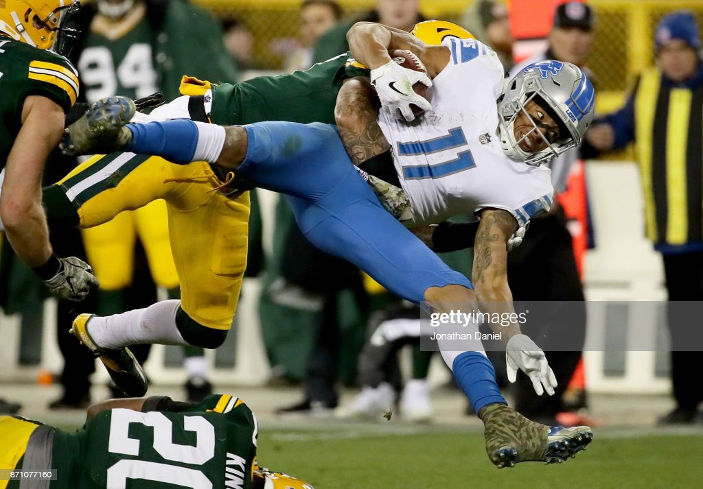 Josh Jones #27 of the Green Bay Packers tackles Marvin Jones Jr. #11 of the Detroit Lions in the fourth quarter at Lambeau Field on November 6, 2017 in Green Bay, Wisconsin.