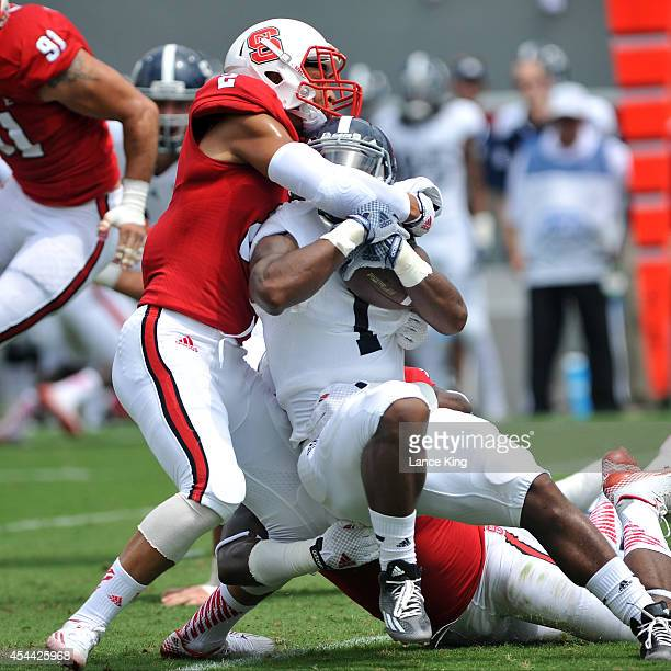 Josh Jones of the North Carolina State Wolfpack tackles Alfred Ramsby of the Georgia Southern Eagles at CarterFinley Stadium on August 30 2014 in...