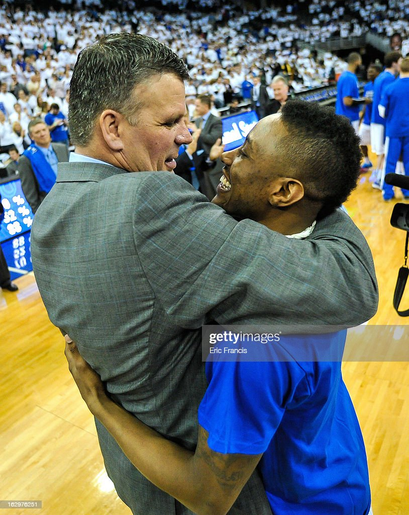 Josh Jones, who was forced to end his career earlier this season due to health issues, receives a hug from head coach <a gi-track='captionPersonalityLinkClicked' href=/galleries/search?phrase=Greg+McDermott&family=editorial&specificpeople=803538 ng-click='$event.stopPropagation()'>Greg McDermott</a> of the Creighton Bluejays during their game at the CenturyLink Center on March 2, 2013 in Omaha, Nebraska.