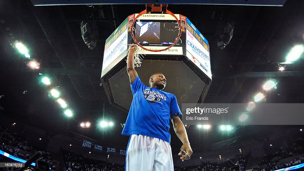 Josh Jones, who was forced to end his career earlier this season due to health issues, waves the net after the Creighton Bluejays defeated the Wichita State Shockers to win the Missouri Valley Conference title at the CenturyLink Center on March 2, 2013 in Omaha, Nebraska.