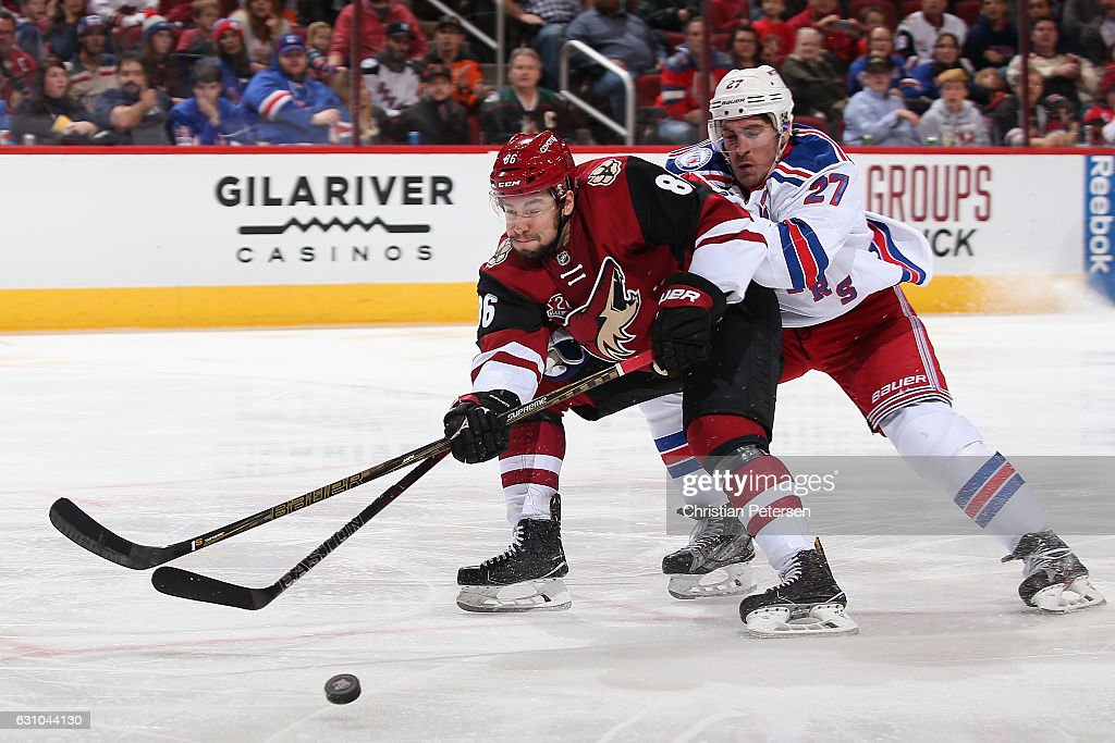 Josh Jooris #86 of the Arizona Coyotes skates after the puck against Ryan McDonagh #27 of the New York Rangers during the third period of the NHL game at Gila River Arena on December 29, 2016 in Glendale, Arizona. The Rangers defeated the Coyotes 6-3.