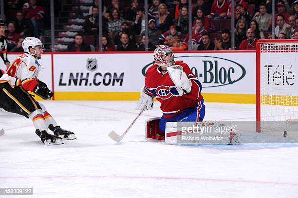 Josh Jooris of the Calgary Flames scores his second goal of the game against Carey Price of the Montreal Canadiens during the NHL game at the Bell...