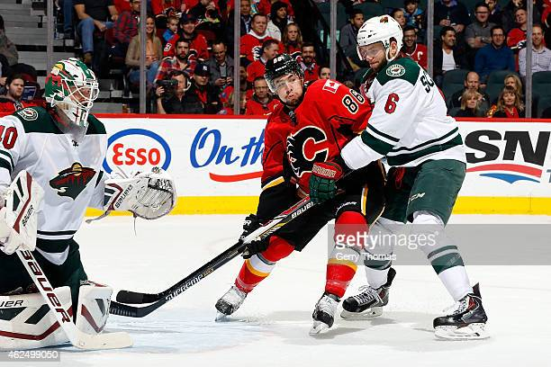 Josh Jooris of the Calgary Flames skates to the net against Marco Scandella of the Minnesota Wild at Scotiabank Saddledome on January 29 2015 in...