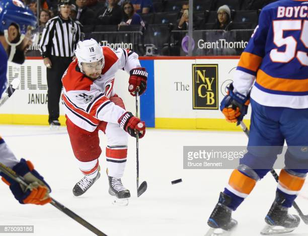 Josh Jooris of the Carolina Hurricanes takes the first period shot against the New York Islanders at the Barclays Center on November 16 2017 in the...