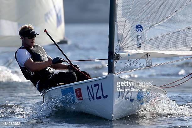 Josh Junior of New Zealand sails in the mens Finn class on the Niteroil course during the International Sailing Regatta Aquece Rio Test Event for Rio...