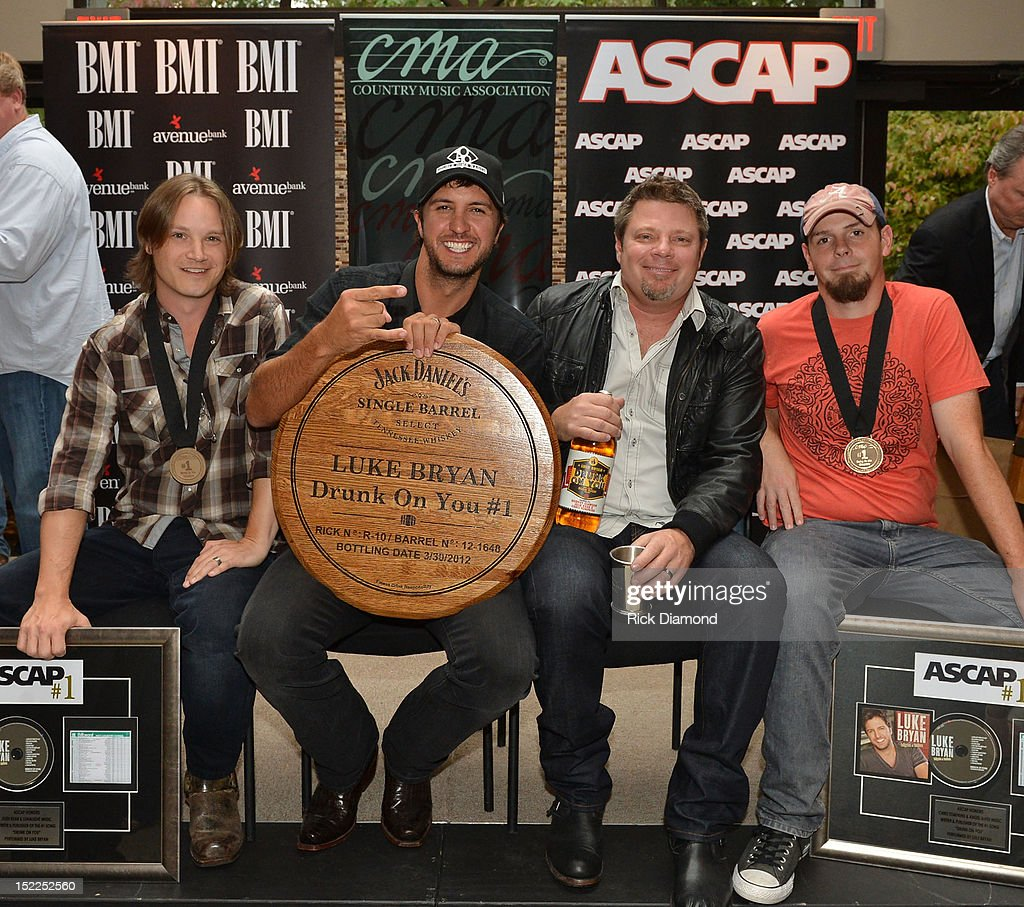 <a gi-track='captionPersonalityLinkClicked' href=/galleries/search?phrase=Josh+Kear&family=editorial&specificpeople=4290587 ng-click='$event.stopPropagation()'>Josh Kear</a> (ASCAP) <a gi-track='captionPersonalityLinkClicked' href=/galleries/search?phrase=Luke+Bryan&family=editorial&specificpeople=4001956 ng-click='$event.stopPropagation()'>Luke Bryan</a> (BMI) Rodney Clawson (BMI) and Chris Tompkins (ASCAP) are honored at The BMI, ASCAP & CMA # 1 Party For 'Drunk On You' Performed By <a gi-track='captionPersonalityLinkClicked' href=/galleries/search?phrase=Luke+Bryan&family=editorial&specificpeople=4001956 ng-click='$event.stopPropagation()'>Luke Bryan</a> (BMI) Co-Writers Rodney Clawson (BMI) Josh Kerr (ASCAP) and Chris Thompkins (ASCAP) at CMA Office on September 17, 2012 in Nashville, Tennessee.