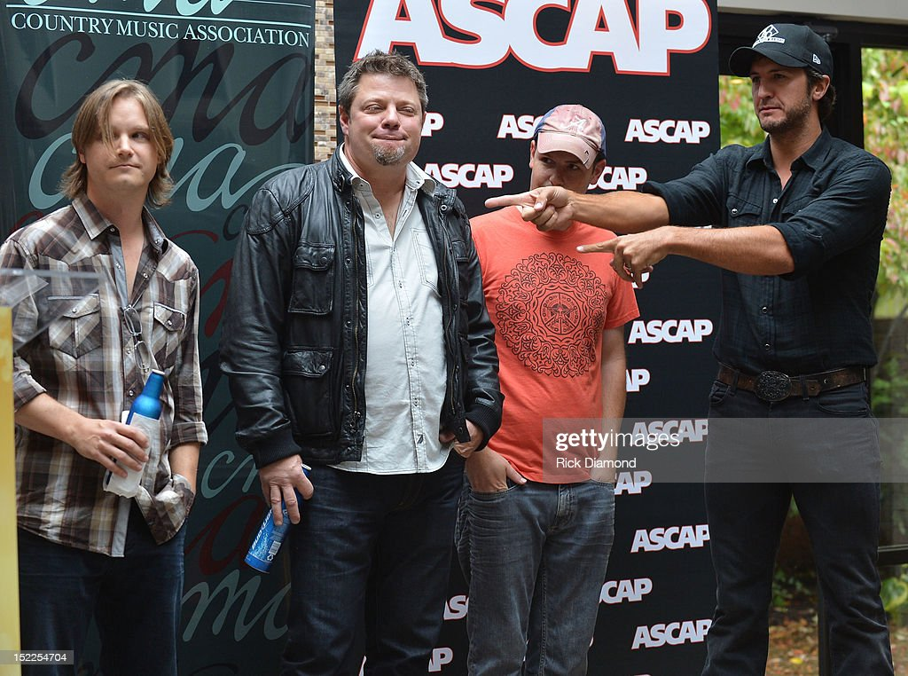 <a gi-track='captionPersonalityLinkClicked' href=/galleries/search?phrase=Josh+Kear&family=editorial&specificpeople=4290587 ng-click='$event.stopPropagation()'>Josh Kear</a> (ASCAP) Rodney Clawson (BMI) and Chris Tompkins (ASCAP) and Luke Bryan (BMI) are honored at The BMI, ASCAP & CMA # 1 Party For 'Drunk On You' Performed By Luke Bryan (BMI) Co-Writers Rodney Clawson (BMI) Josh Kerr (ASCAP) and Chris Thompkins (ASCAP) at CMA Office on September 17, 2012 in Nashville, Tennessee.
