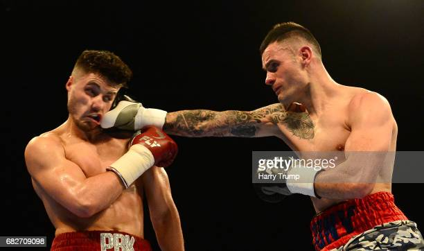 Josh Kelly and Jony Vina exchange punches during the Welterweight Contest between Josh Kelly and Jony Vina at the Barclaycard Arena on May 13 2017 in...