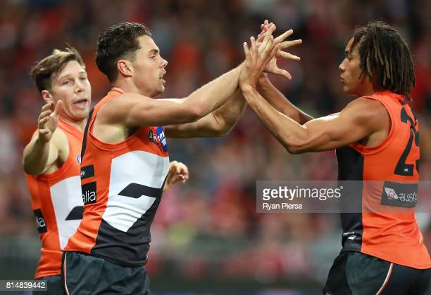 Josh Kelly of the Giants celebrates a goal with Tendai Mzungu of the Giants during the round 17 AFL match between the Greater Western Sydney Giants...