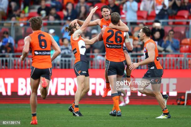 Josh Kelly of the Giants celebrates kicking a goal during the round 19 AFL match between the Greater Western Sydney Giants and the Fremantle Dockers...