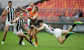 Josh Kelly of the Giants is tackled by Brayden Maynard of the Magpies during the round 16 AFL match between the Greater Western Sydney Giants and the...