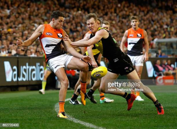 Josh Kelly of the Giants is tackled by Jack Riewoldt of the Tigers during the 2017 AFL Second Preliminary Final match between the Richmond Tigers and...