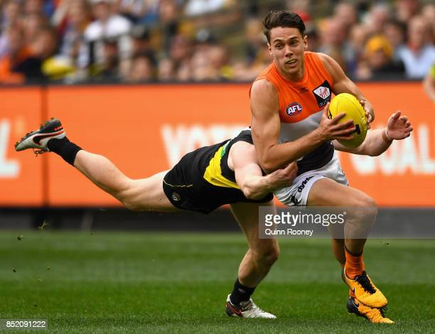 Josh Kelly of the Giants is tackled by Jacob Townsend of the Tigers during the Second AFL Preliminary Final match between the Richmond Tigers and the...