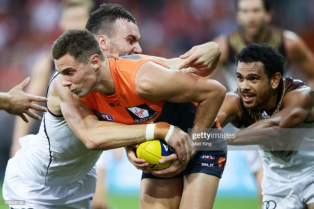 Josh Kelly of the Giants is tackled during the round six AFL match between the Greater Western Sydney Giants and the Hawthorn Hawks at Spotless Stadium on April 30, 2016 in Sydney, Australia.