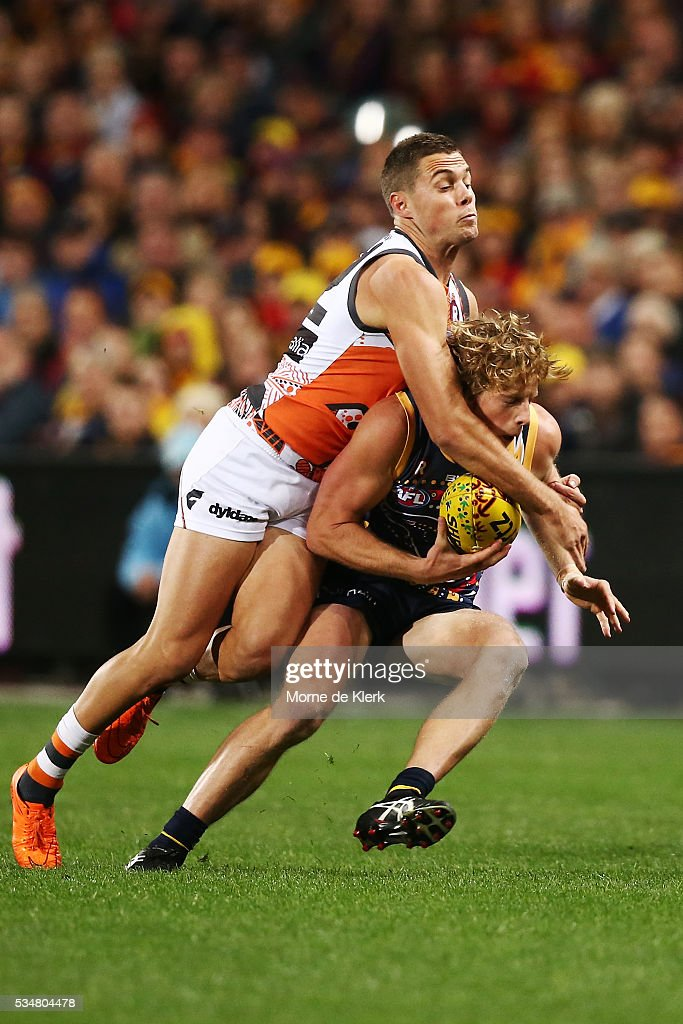 Josh Kelly of the Giants tackles Rory Sloane of the Crows during the round 10 AFL match between the Adelaide Crows and the Greater Western Sydney Giants at Adelaide Oval on May 28, 2016 in Adelaide, Australia.