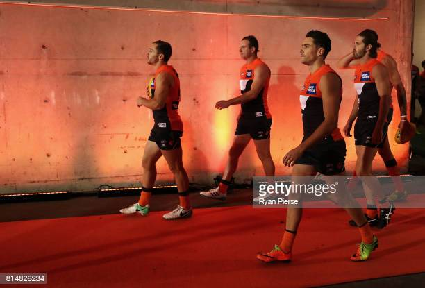 Josh Kelly of the Giants walks out onto the ground during the round 17 AFL match between the Greater Western Sydney Giants and the Sydney Swans at...
