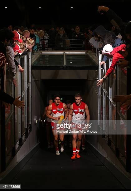 Josh Kennedy and Kieran Jack of the Swans walk out after half time during the round eight AFL match between the Hawthorn Hawks and the Sydney Swans...