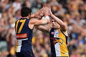 Josh Kennedy and Luke Shuey of the Eagles celebrate a goal during the round 17 AFL match between the West Coast Eagles and the Sydney Swans at Domain...