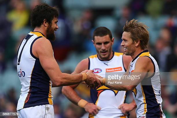 Josh Kennedy and Mark LeCras of the Eagles celebrate a goal during the round 20 AFL match between the Fremantle Dockers and the West Coast Eagles at...