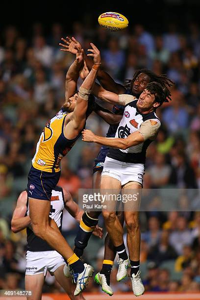 Josh Kennedy and Nic Naitanui of the Eagles contest a mark against Michael Jamison of the Blues during the round two AFL match between the West Coast...