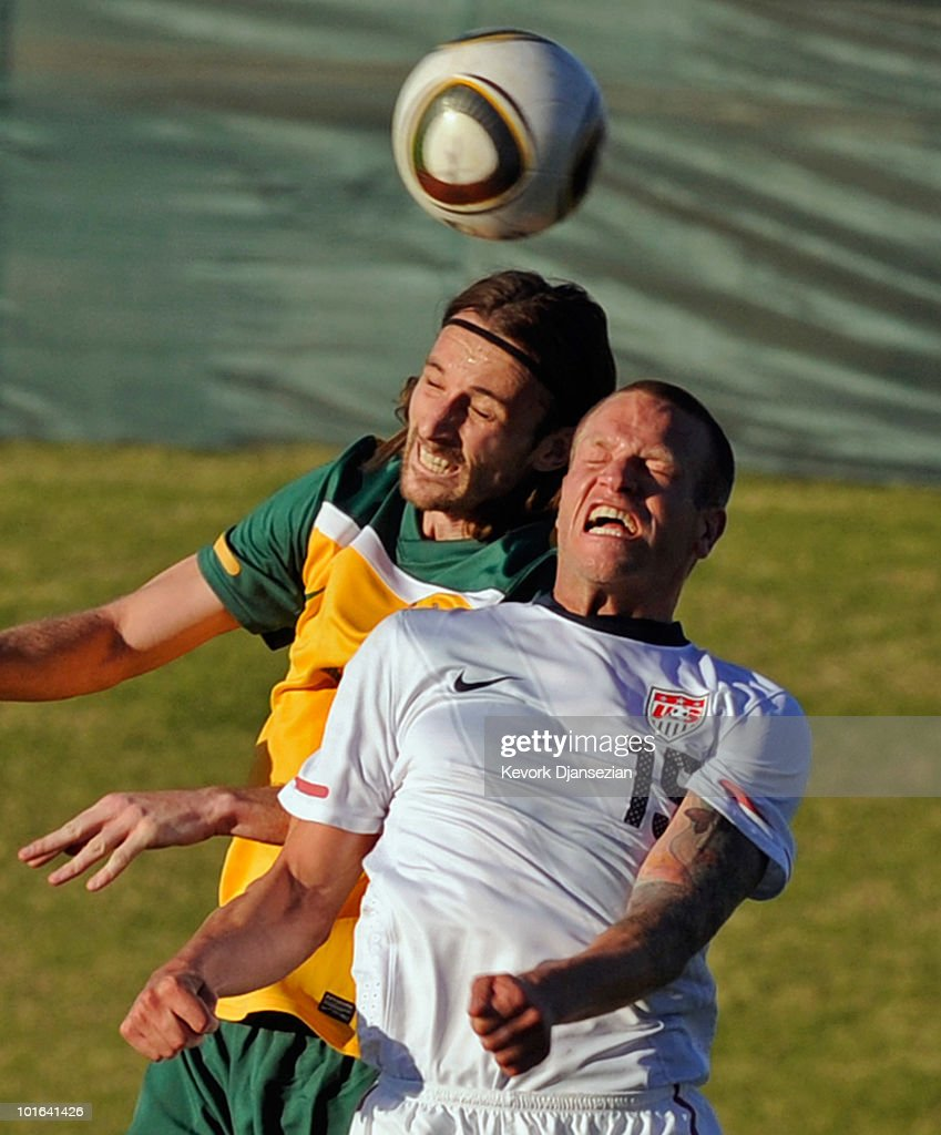 Josh Kennedy #9 of Australia and Jay DeMerit #15 jump for a header during second half of the 2010 FIFA World Cup Pre-Tournament match between the Australian Socceroos and the United States of America at Ruimsig Stadium on June 5, 2010 in Roodepoort, South Africa. USA won, 3-1.