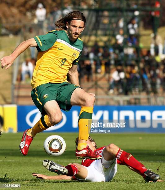 Josh Kennedy of Australia leaps over his opponent during the International Friendly between the Australian Socceroos and Denmark at Ruimsig Stadium...