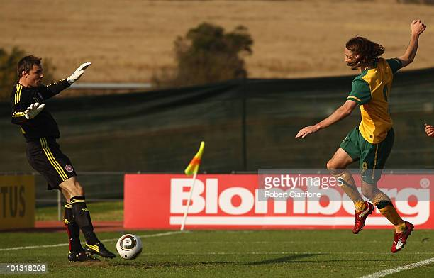 Josh Kennedy of Australia scores past Stephan Andersen of Denmark during the International Friendly between the Australian Socceroos and Denmark at...
