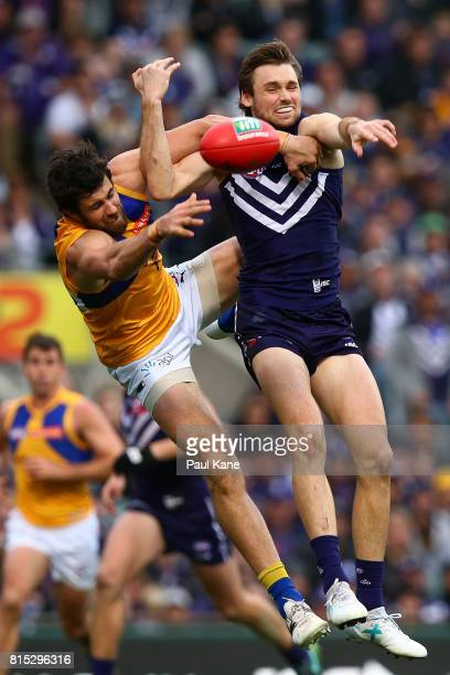 Josh Kennedy of the Eagles and Joel Hamling of the Dockers contest a mark during the round 17 AFL match between the Fremantle Dockers and the West...