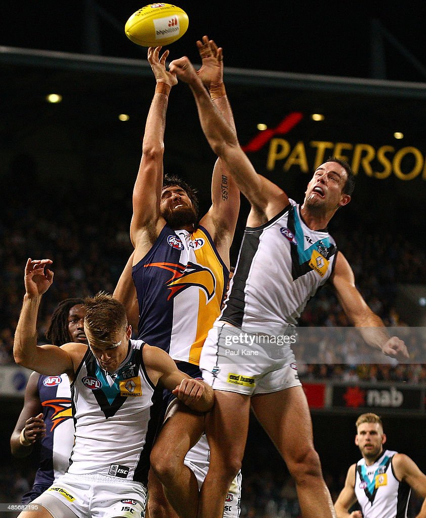Josh Kennedy of the Eagles and Matthew Broadbent of the Power contest a mark during the round five AFL match between the West Coast Eagles and the Port Power at Patersons Stadium on April 19, 2014 in Perth, Australia.