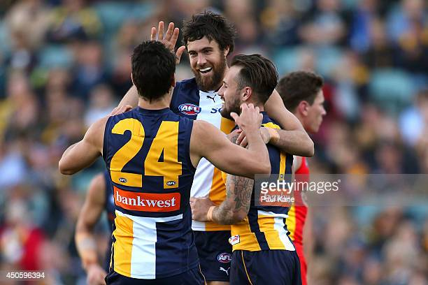Josh Kennedy of the Eagles celebrates a goal with Matt Rosa and Chris Masten during the round 13 AFL match between the West Coast Eagles and the Gold...