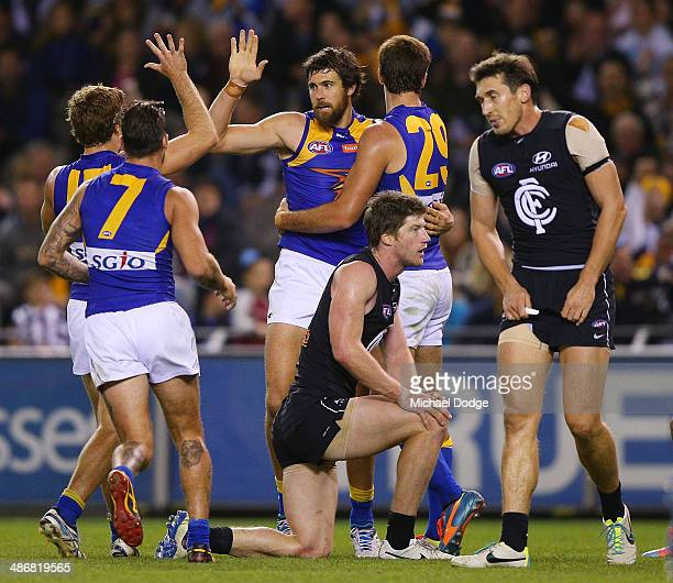Josh Kennedy of the Eagles celebrates a goal with teamates as Sam Rowe and Michael Jamison of the Blues react during the round six AFL match between...