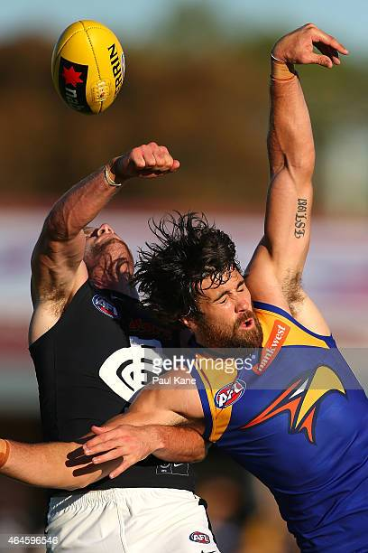 Josh Kennedy of the Eagles has his mark spoilt by Sam Rowe of the Blues during the NAB Challenge AFL match between the West Coast Eagles and the...
