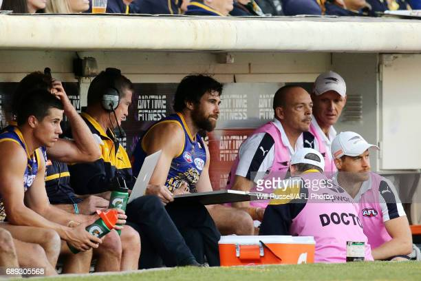 Josh Kennedy of the Eagles is checked by the doctor after a suspected achilles injury during the round 10 AFL match between the West Coast Eagles and...